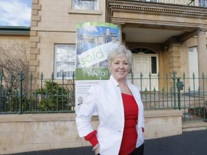 Fall agent Jeanne Best in front of 22 De Witt Street, Battery Point which she sold recently. Picture - Matt Thompson